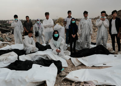 To keep a track record, the group takes a photo each day with all the collected bodies. Mosul, April 2018