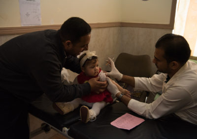 Vaccination of a young girl. Fallujah, March 2019.