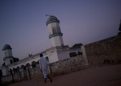 A man on his way to the evening prayers. Serekunda, The Gambia 2016