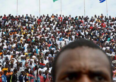 A man watches the inauguration ceremony of Adama Barrow. Serekunda, The Gambia 2016