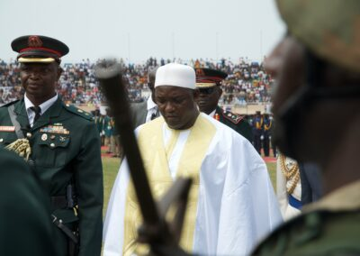 Adama Barrow during the inauguration ceremony surrounded by members of the military. Serekunda, The Gambia 2016