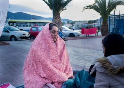 Adele protects herself from the cold during the occupation of Saphos Square. Lesvos, November 2017