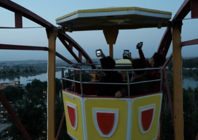 Youngsters taking selfies in the Ferris Wheel. Mosul, June 2018