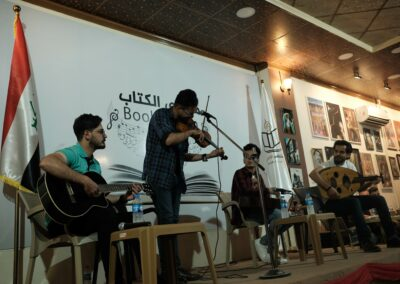 Musicians play a concert in the newly opened Book Cafe. Mosul, May 2018.