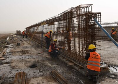 Workers repair a bridge which was destroyed by the Islamic State (IS). Anbar, January 2019.