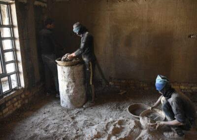 Construction workers rehabilitating houses. Ramadi, January 2019.
