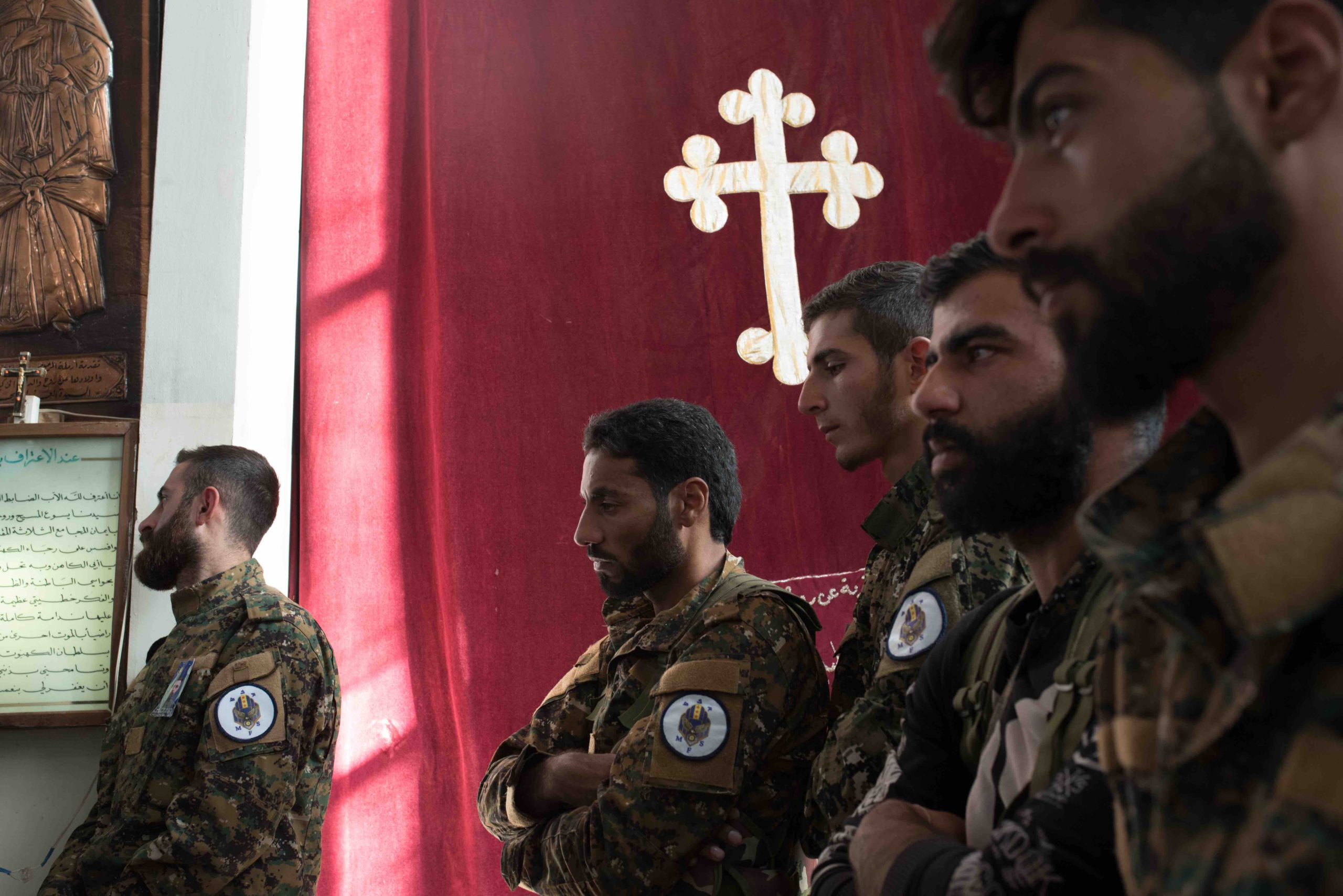 Members from the Syria Military Council (MFS), the main armed Christian militia in Northeastern Syria, during the funeral for one of its members. The MFS militia has more than 2000 members and is allied with the Kurdish People Protection Unit (YPG). Hassakeh, 22.11.19